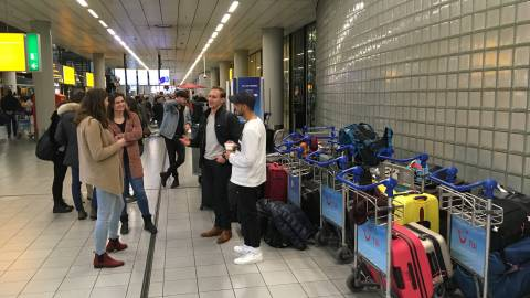 Pick Up Service EUR at Schiphol - students chatting the time away