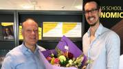 Enrico Penning congratulating Jan Stoop with flowers